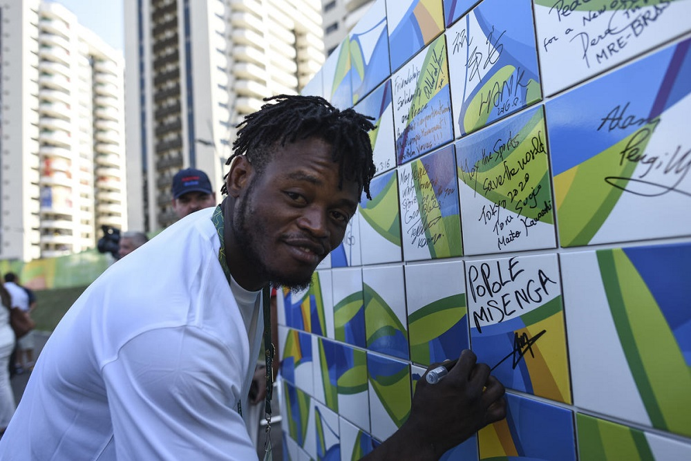 Brazil. Congolese judoka signs the Olympic Truce Wall in Rio