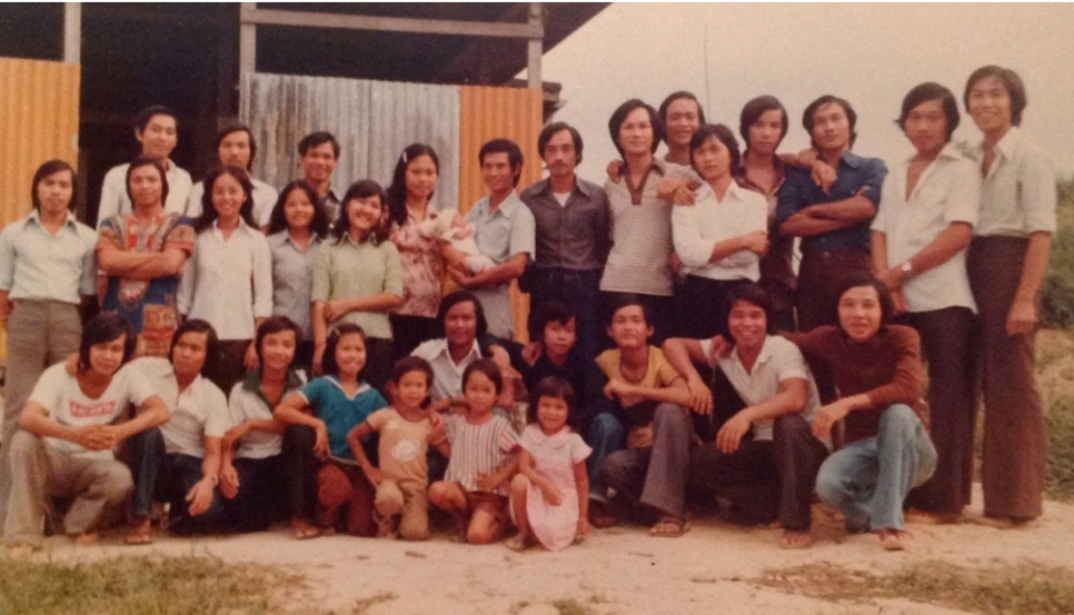 Outdoor group photo of some 30 refugees who fled Viet Nam in 1979 on the same boat as Jennifer Xu's aunt.