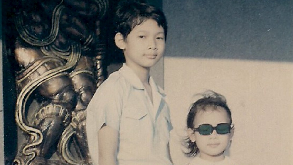 Two Vietnamese children pose for a photo in 1974 on a sidewalk in what was then Saigon, South Vietnam.